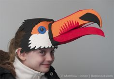 Use Venetian mask as bird base- make ruby throated hummingbird then add lots of flowers and insects Green tutu skirt around neck, leaf hands, green top and brown pants? Headband Crafts, Hat Crafts, Toucan Craft, Lion King Jr, Bird Masks, Bird Costume, Festival Gear, Animal Costumes, Diy Costumes