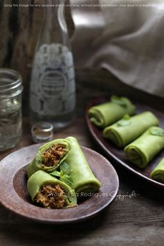 Singapore Street Food - kueh dadar or pandan crepes filled with melted brown sugar, palm sugar and shredded coconut