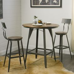 Our handsome Hudson Pub Table exudes big-city style that recalls the early 20th-century industrial era. Expertly crafted of a metal base and acacia wood with a weathered finish, this tall pub table is equally casual and budget conscious.