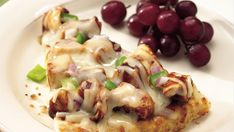 If you've never tried cooking pizza on the grill, give this delicious cheesy chicken version a try, made ultra-easy with refrigerated pizza dough.
