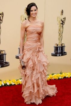 What: Atelier Versace Where: Academy Awards in 2010 Why: Moore displayed a more romantic side than we're used to seeing from her with this blush cascading ruffled gown.  Getty Images  - HarpersBAZAAR.com