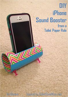 The DIY iPhone Sound Booster I made from a toilet paper role! It takes just a few minutes and is so easy! 1. Get a TP role and whatever duck tape you want 2. Measure and cut a slit in the TP role for your iPhone 3. Cover the TP role with duck tape anyway you want 4. Add thumbtacks to the bottom as feet to hold it up 5. (Optional) add clay/ duck tape to cover up the thumbtack points inside the TP role 6. Start listening to music! Find the original directions here…