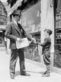 perfect! Newspaper boy sells  paper to business man! :)