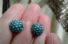 Antique Pave set Turquoise Domed button style srew back earrings    Stones range from blue to green turquoise     Size against a 5 pence coin    I bought them as silver gilt but hey are unmarked. The mounts are silver in colour and the screw backs are gilt coloured    There are several small chips seen through a magnifyer and one of the screw backs has a slight dent    Very pretty earrings possibly late Victorian.     Thanks for viewing | eBay!