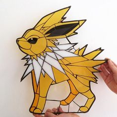 Today Jolteon will cross the water to find his new home, wish him and his new owner well! Pokemon stained glass piece made by the Stained Glass Geek