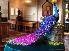 Dendrobium Orchid Peacock Floral Architecture Piece Designed by The French Bouquet Michaels peacock in the entry