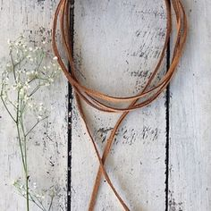 Suede Choker  Wood boho beads at end. Not free people, in it for publicity Free People Jewelry Necklaces