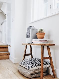 Use every space in hallways if you have. Like this idea of Scandinavian wooden design bench and a storage mix - books, plans and vases and soft trough and cushion underneath. Fun and a bit different.