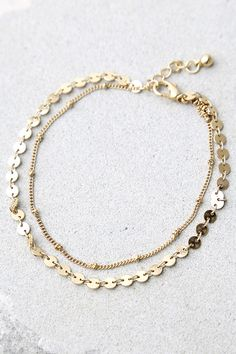 """Follow the sunshine straight to the Escape to Sun Gold Anklet! Two layers of dainty gold chain form this cute anklet. Anklet measures 8.25"""" long with 1"""" extender chain."""