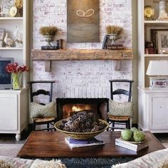 Whitewashed brick fireplace with rustic mantle