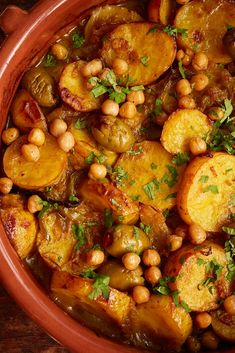 Our delicious vegan tagine recipe is perfect for a chilly autumnal evening. Potatoes, olives and preserved lemons are slowly cooked down with plenty of spices and topped with crispy chickpeas for a … Vegan Tagine Recipe, Vegetarian Tagine, Tagine Recipes, Vegetarian Recipes, Cooking Recipes, Savoury Recipes, Olive Recipes, Lemon Recipes, Tagine Cooking