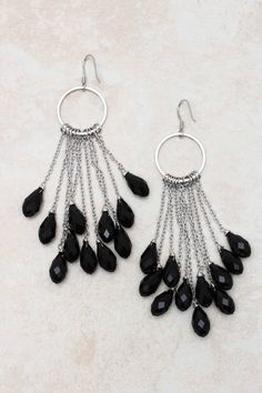 "Jaden Chandelier Earrings on Emma Stine Limited-- Jet Crystal Briolette Teardrops suspended from layers of Silver.     EARRINGS SIZE: 3""L x 1""W   EARRINGS CLOSURE: Fish hook ear wire     Hypo Allergenic / Silver Plated / Crystals  $48"