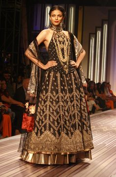 Models walk the ramp for Grand Finale by designer  Ritu Kumar at the Wills Lifestyle India Fashion Week 2013 in New Delhi.