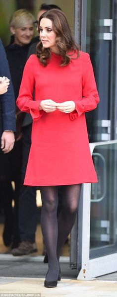 The Duchess looked festive in a simple but cheerful red dress from Goat...