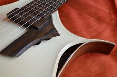 Most luthiers today spend their time honing their craft, designing and creating guitars (vintage or modern) that eventually become a standard model in their product lineup. Once the standard model… Custom Electric Guitars, Custom Guitars, Guitar Diy, Acoustic Guitar, Cold Fusion, Guitar Design, Music Instruments, Woodworking, Lineup