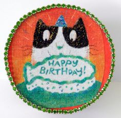 Birthday cat can't wait to get to his fish birthday cake!
