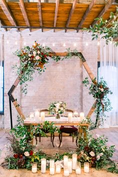 Lageret Stoughton, WI Wedding Photography A boho theme sweetheart table surrounded by candles and the re-used octagon ceremony arch. Deep burgundy and white flowers with a lot of greenery. Wedding Wall, Boho Wedding, Floral Wedding, Wedding Flowers, Wedding Reception, Table Wedding, Wedding Arch Greenery, Wedding Arches, Sweetheart Table Backdrop
