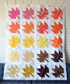 Must do something like this with rusts, oranges, yellows, lime, green, tan & browns. Must. Modern Maples Quilt Top Complete!