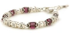 """A Birthstones Name Bracelet for a child. Lead-free crystal birthstones mixed with sterling silver and bali silver spacers will make any child feel special. Name spelled out in sterling silver letter beads makes this the perfect personalized keepsake.  Bracelet comes with a heart shape lobster clasp, 1"""" of extension chain and a charm of your choice.  This style is also available in adult sizes and Mommy & Me Bracelet sets. [ LilyBrookeJewelry.com ]"""