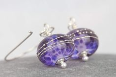 Purple glass beaded earrings ~ statement jewellery ~ lampwork beads~ inspirational earrings ~ silver dangles ~ drop earrings for women by AmySquaredJewellery on Etsy https://www.etsy.com/uk/listing/523083405/purple-glass-beaded-earrings-statement