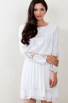 Beautiful Romantic White Dress with crochet accents.  The Escapades Crochet Dress is a feminine must have