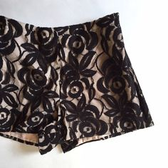 """Vivian Diamond Lace High Waist Black/Beige Shorts Amazing high waist lace shorts. New without tag. Discontinued online and in store. Lined inside. Zip and hook and eye closure on one side, pocket on other. Elastic Waist. Perfect for just looking hot whenever you want. Also perfect for a bridal gift cause the groom will be wanting to see the bride in these, as will pretty much everyone else. Marked XS, but will also fit a Small because of elastic waist.   Length: 11.5"""" Inseam: 2.8"""" Leg…"""