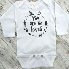 Harry Potter Inspired Baby Onesie This onesie will get lots of compliments:) 100% pure soft cotton is gentle on your babys skin. Please visit