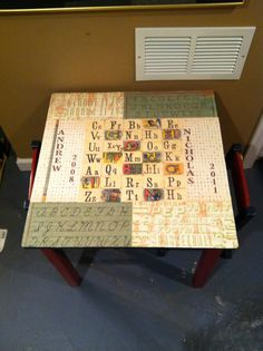 Decoupage kids play table with the boys names and birth years!