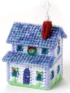 plastic canvas house ornament - check out all the details in this tiny space. And I love how the variegated yarn really works well for the roof.