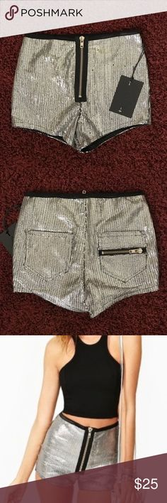 NWT UNIF Sequin Shorts Hot pants Size M Brand new with tags never worn UNIF sequin shorts… I thought I was going to wear these but I never had the occasion. They're a size medium. There are three sequins missing from the front, but not too noticeable. UNIF Shorts