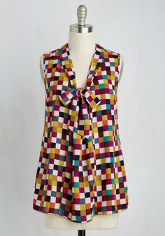 Take your wardrobe on a vivacious vacation with this eye-catching top! Its collection of richly colored squares make a night in Miami all the more fun, while its chic tie neckline makes you the most stylish gal on the shoreline.