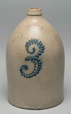 "19TH CENTURY THREE-GALLON STONEWARE JUG stamped ""Troy, N.Y. Pottery"" above a cobalt blue ""3"". Height 15.5""."
