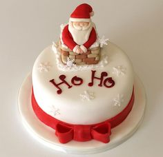 Christmas cake with red ribbon band and Santa in chimney