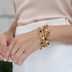 Light and delicate, this thin hammered gold plate bangle has six hand set gemstones dotting its circumference. Shop this favorite: Plain Gold Bangles, Gold Bangles Design, Silver Bangle Bracelets, Gold Jewellery Design, Gold Jewelry, Healing Bracelets, Pandora Jewelry, Stone Jewelry, Jewlery