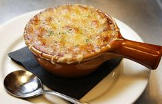 Onion Soup with gruyere cheese and toasts under the cheese