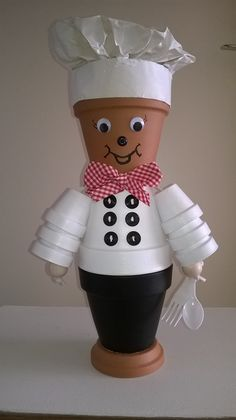 Cute little baker made from clay pots.  The white is in fact clay pots painted white, they are NOT styrofoam.