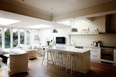 I really love the open floor plan! The large windows and white kitchen really give this area a light, cozy feel.