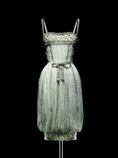 "From the upcoming Dior: 60th Anniversary -- ""Armide,"" a white tulle and silver sequin short evening gown from 1959."