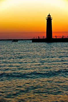 Oh the Hours we spent on the boat in this cove, watching the sunset of Lake Michigan.    Muskegon, Michigan  Lake Effect Boat Time