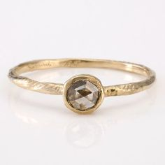 18K yellow gold $840     0.18 carat cognac color rosecut diamond  1.2 mm (width of band)      http://satomikawakita.com/512-5292/R1001B