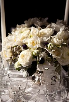 Brides.com: Winter Wedding Flowers. Wedding centerpiece of dusty miller, silver brunia, anemones, ranunculuses, and tulips by Melarosa  Inc. Browse more winter wedding centerpieces.