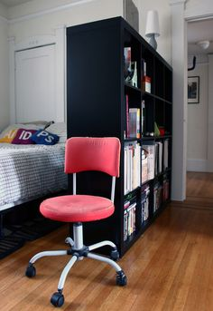 Like the idea of a bookcase as a room divider. Especially since the folded dividers are SO expensive