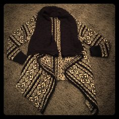 Navy and cream sweater cardigan This cardigan is a heavy material that is navy with cream patterns all over it.  The neck part of the cardigan folds down and is navy.  The sleeves are long-sleeve and the front comes down longer than the back on the cardigan.  This has only been worn a few times and is in excellent condition with no rips or stains  Cliche Couture Sweaters Cardigans