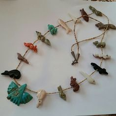 """Vintage Native,American Zuni Fetish Necklace Beautiful Fetish animal necklace from the 70's 32"""" Long 2 animals,have damage(missing tails) the Turquoise Thunderbird looks like it has a divet  out of it but that is the stone not damage( see picture 4) animal are fishes, foxes, rabbit, bears, and birds. Hook is Silver but needs polishing. Jewelry Necklaces"""