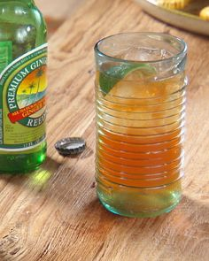 Ginger Rum Drink - another way to use spiced rum? - rum, bitters, 12 oz ginger beer, lime wedges for garnish. Fruit Drinks, Smoothie Drinks, Beverages, Smoothies, Ginger Cocktails, Cocktail Drinks, Cocktail Recipes, Refreshing Drinks, Summer Drinks