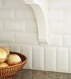 """Instead of having a granite 4"""" back splash, just turn your subway tile vertical! A fun and interesting detail."""
