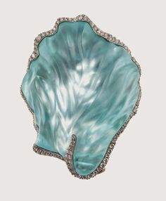 Brooch featuring an 80-ct. hand-carved aquamarine set in 18k white gold with VS-G white diamonds.