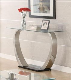Enhance the flow of your contemporary style throughout your living room with this coffee table. It features striking curved metal legs with a high sheen black b