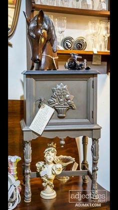 """Located in our gallery @Adjectives Market, Altamonte Springs - """"Copper Lined Humidor, Circa 1800s – In very rough condition – completed sanded, painted, stained and sealed.  Cooper cleaned!  Great details with original center finial and great carved legs!   25"""" Tall x 17""""Wide  x 11"""" Deep      $175 Carved Wood   SOLD   Horse Head:  $129  French Female Bust - $55 -- SOLD"""