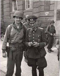 US Army junior officer poses for the cameraman with a German general after Germany's surrender in May 1945.